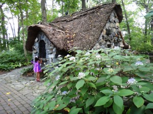 Peer inside the Faerie Cottage in Enchanted Woods to find a cool spot to rest.