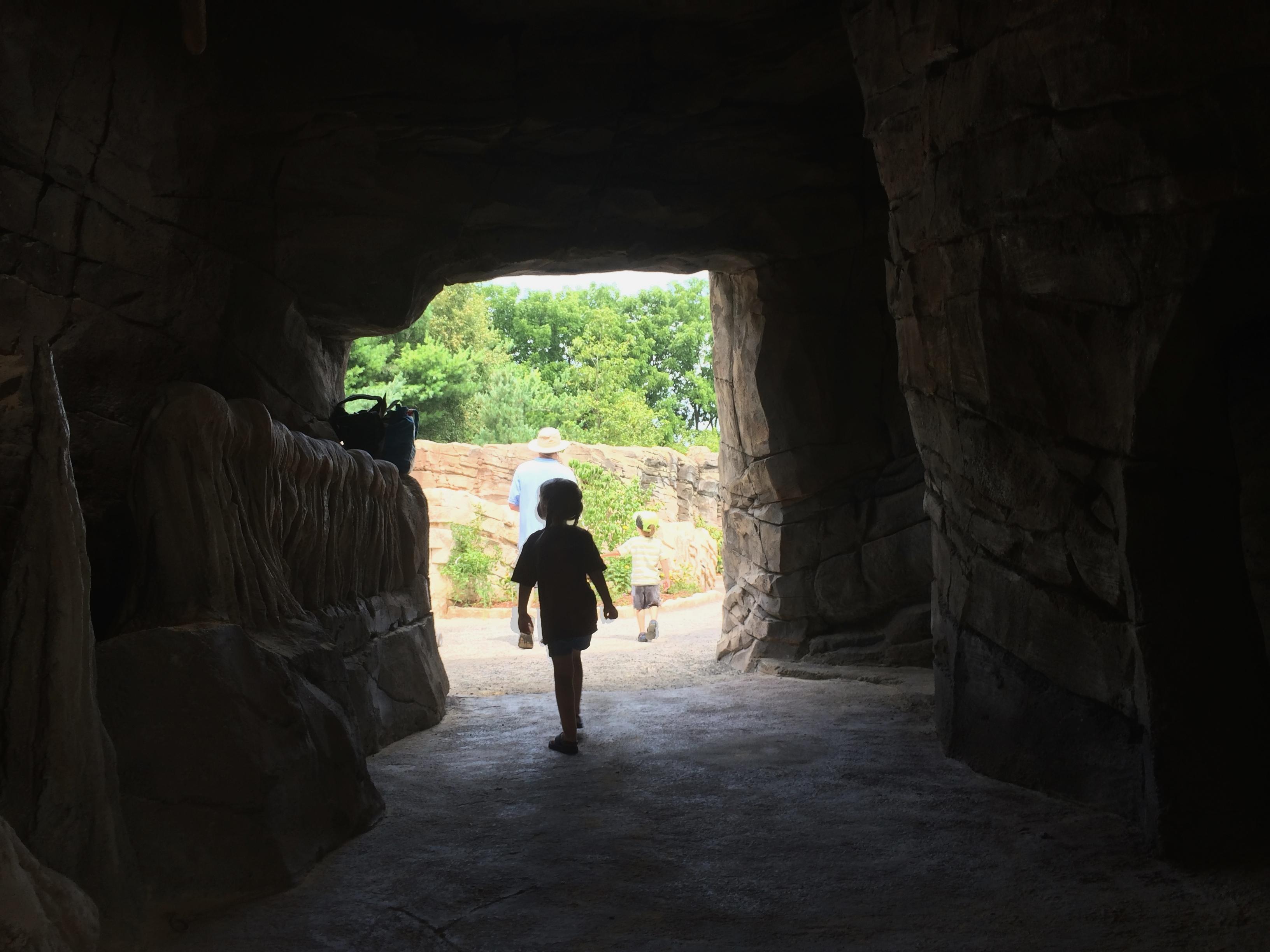 Child Going Through Cave