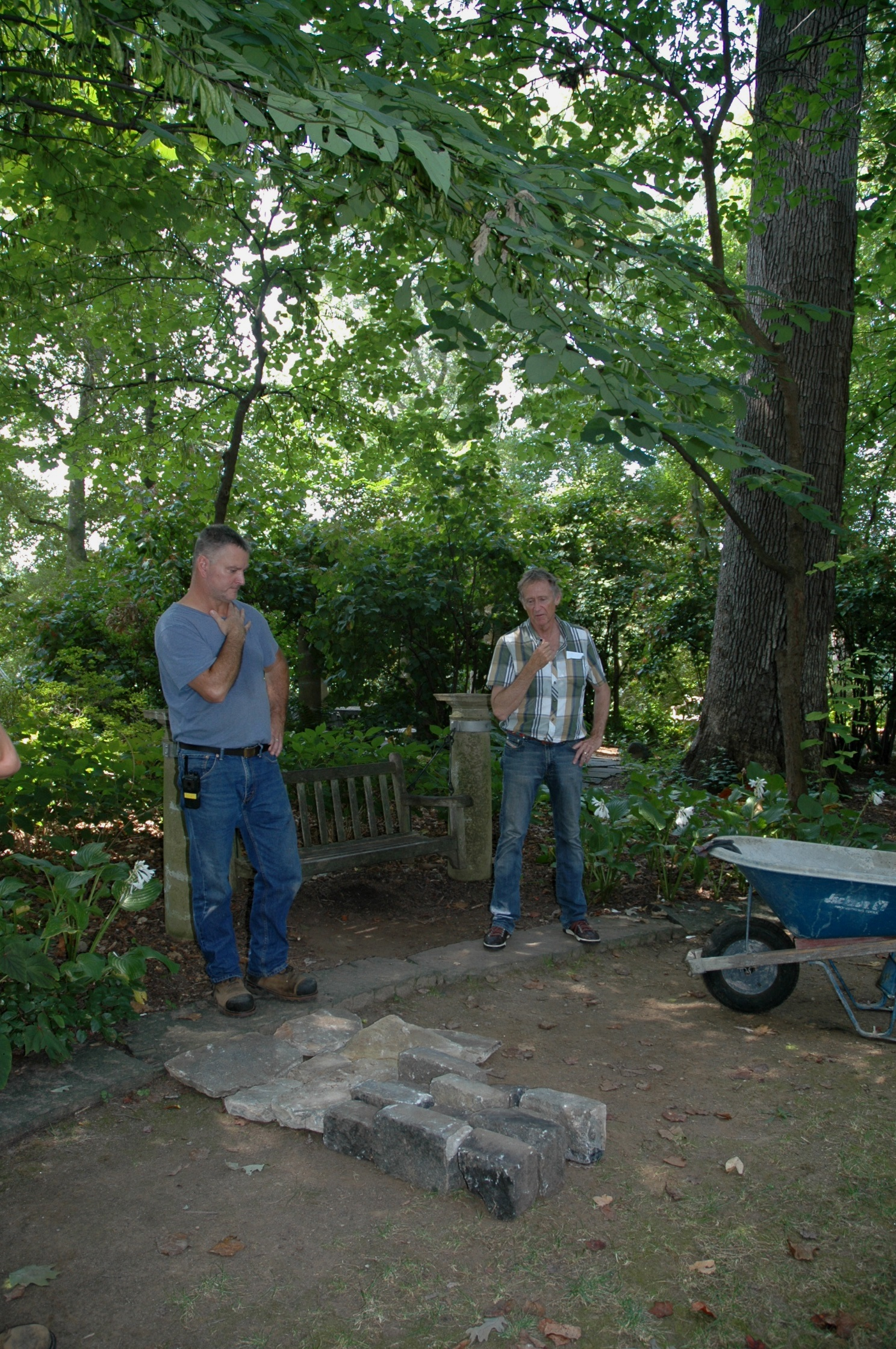 Arborist Supervisor John Salata and Landscape Architect W. Gary Smith work on the stone mockup