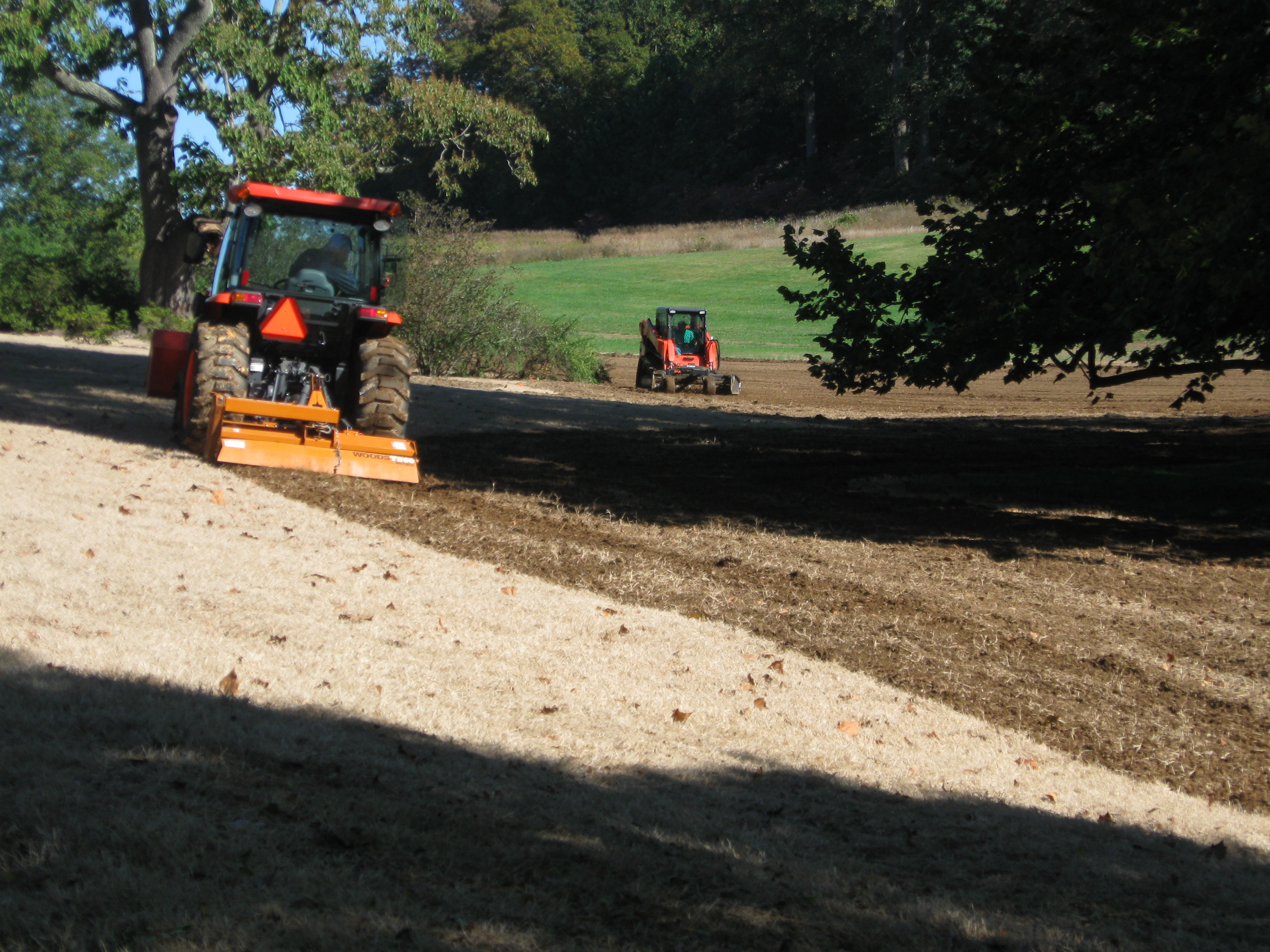 """Tiller and """"Grass Cleaner-Upper"""" in action prepping the soil"""
