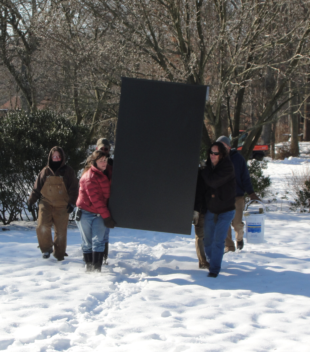 Garden team bringing out one of the iron lily enclosures, winter 2013
