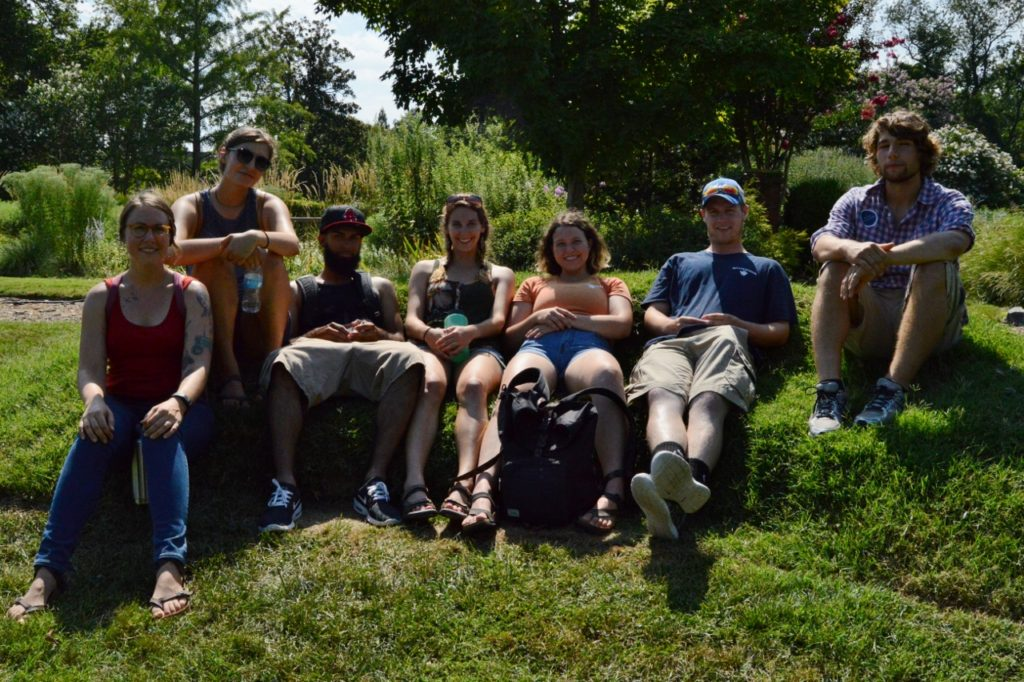 """The interns take a break on a """"sofa"""" made entirely of sod (Augusta is second from left)"""